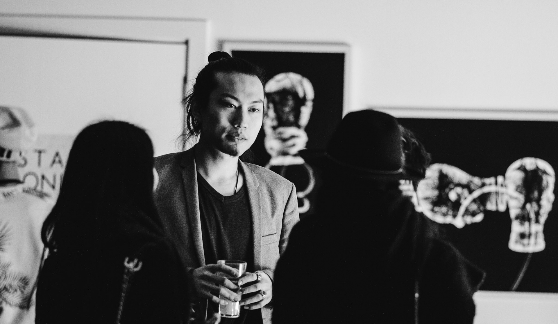 Black and white photograph of the Shoreditch Fashion Show- pictured is a man in a blazer. Graphic design by Barefaced Studios, design agency based in Islington, North London.