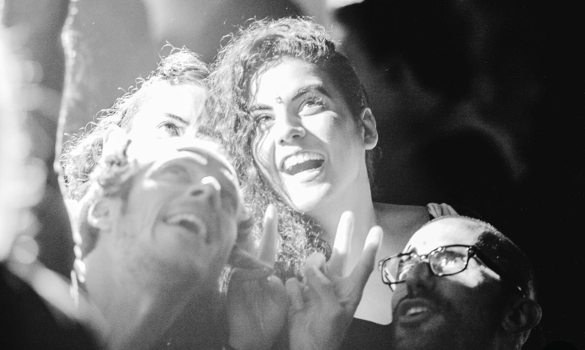 Black and white photograph of the Shoreditch Fashion Show- pictured are people taking a selfie. Graphic design by Barefaced Studios, design agency based in Islington, North London.
