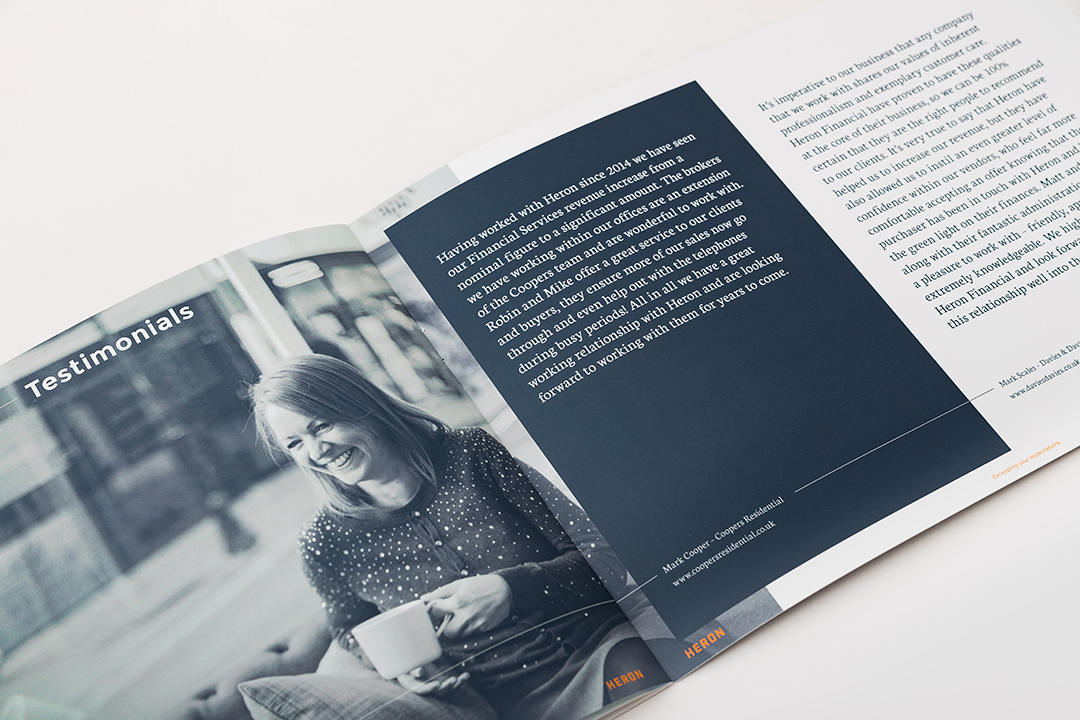 An open brochure, with image of woman sipping coffee- designed for Heron Financial, Mortgage and Insurance Brokers. Graphic design by Barefaced Studios, design agency based in Islington, North London.