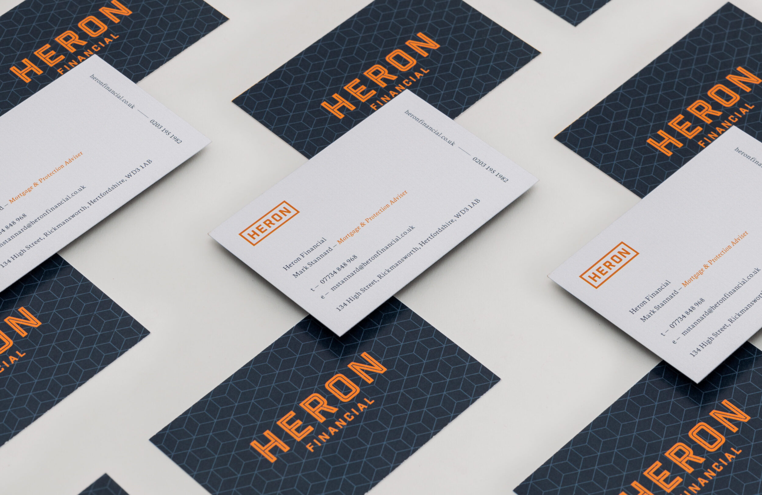 Heron Financial, mortgage brokers London, business cards. Graphic design by Barefaced Studios, design agency Islington.