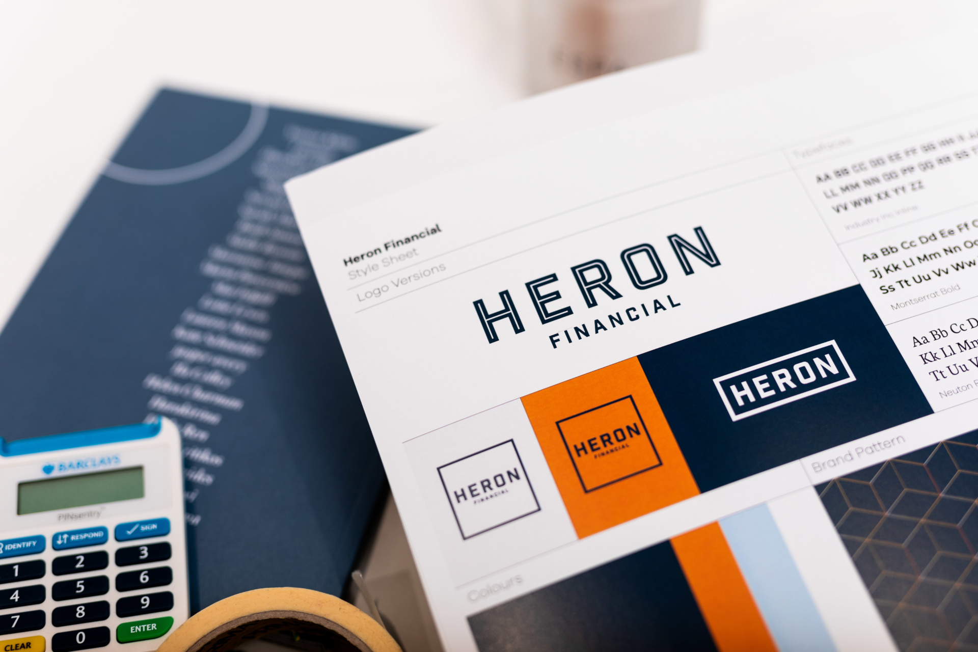 Brand Identity and logos for Heron Financial, mortgage and insurance brokers. Graphic design by Barefaced Studios, design agency Islington.