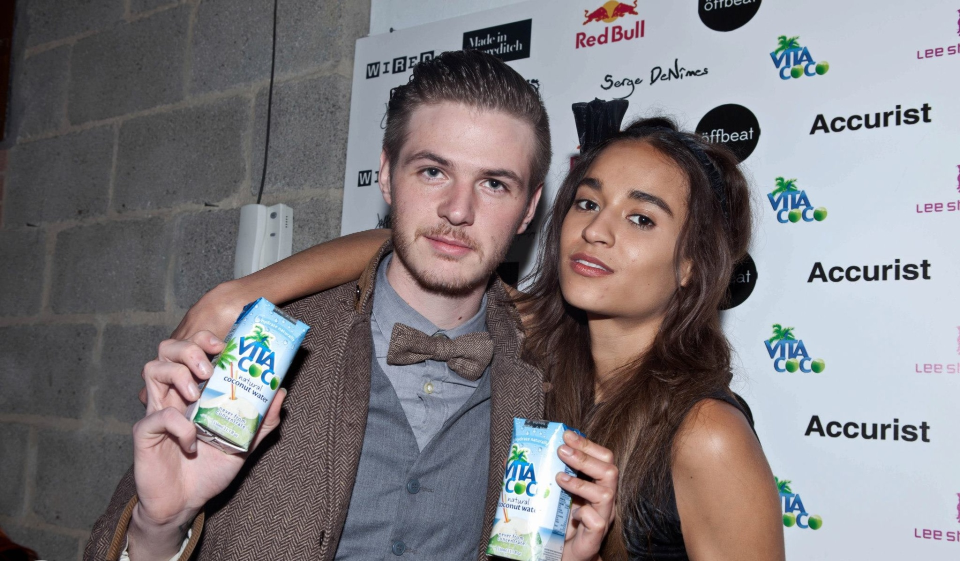 Photograph of the Shoreditch Fashion Show- two people holding coconut milk. Graphic design by Barefaced Studios, design agency based in Islington, North London.