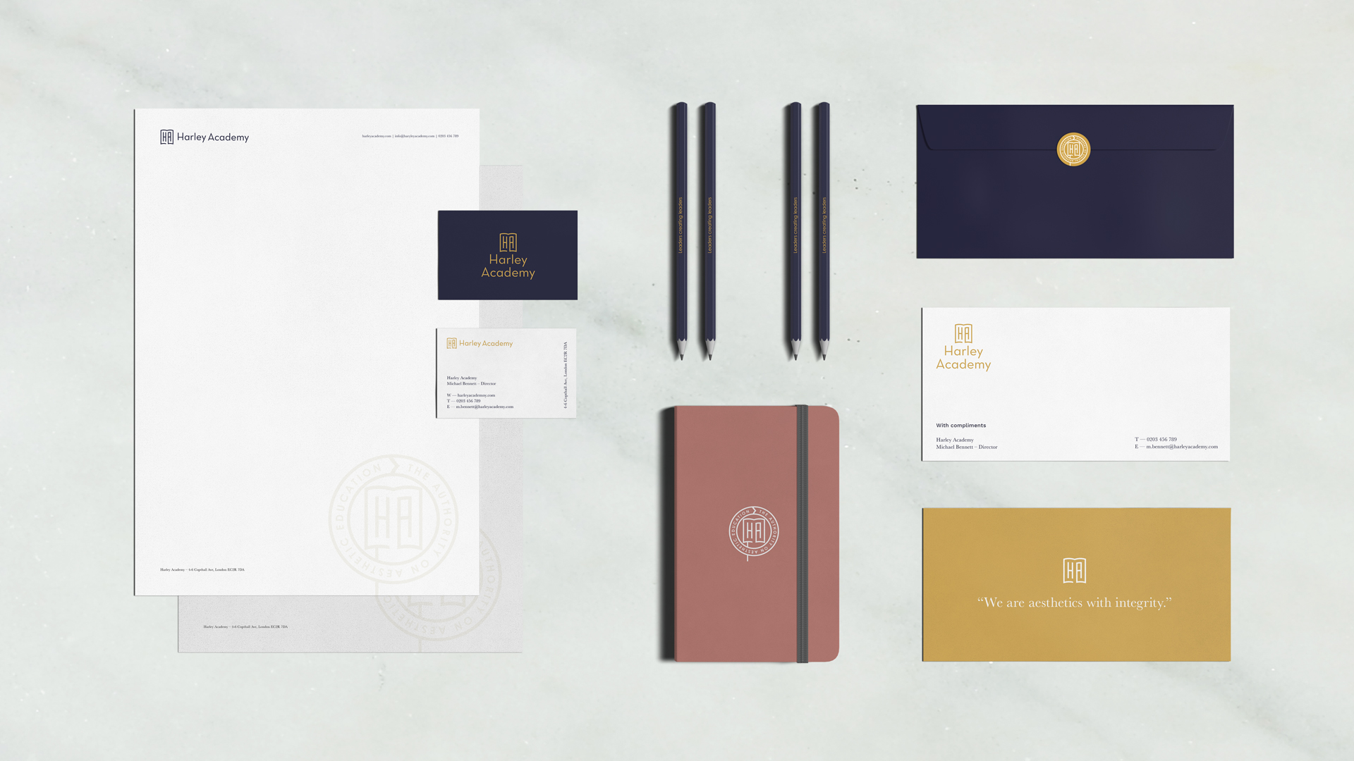 Mock up of stationary for Harley Academy- including letterheads, business cards, pencils, envelopes, notebooks and leaflets. The brand identity and graphic design by Barefaced Studios, Design Agency in Islington.