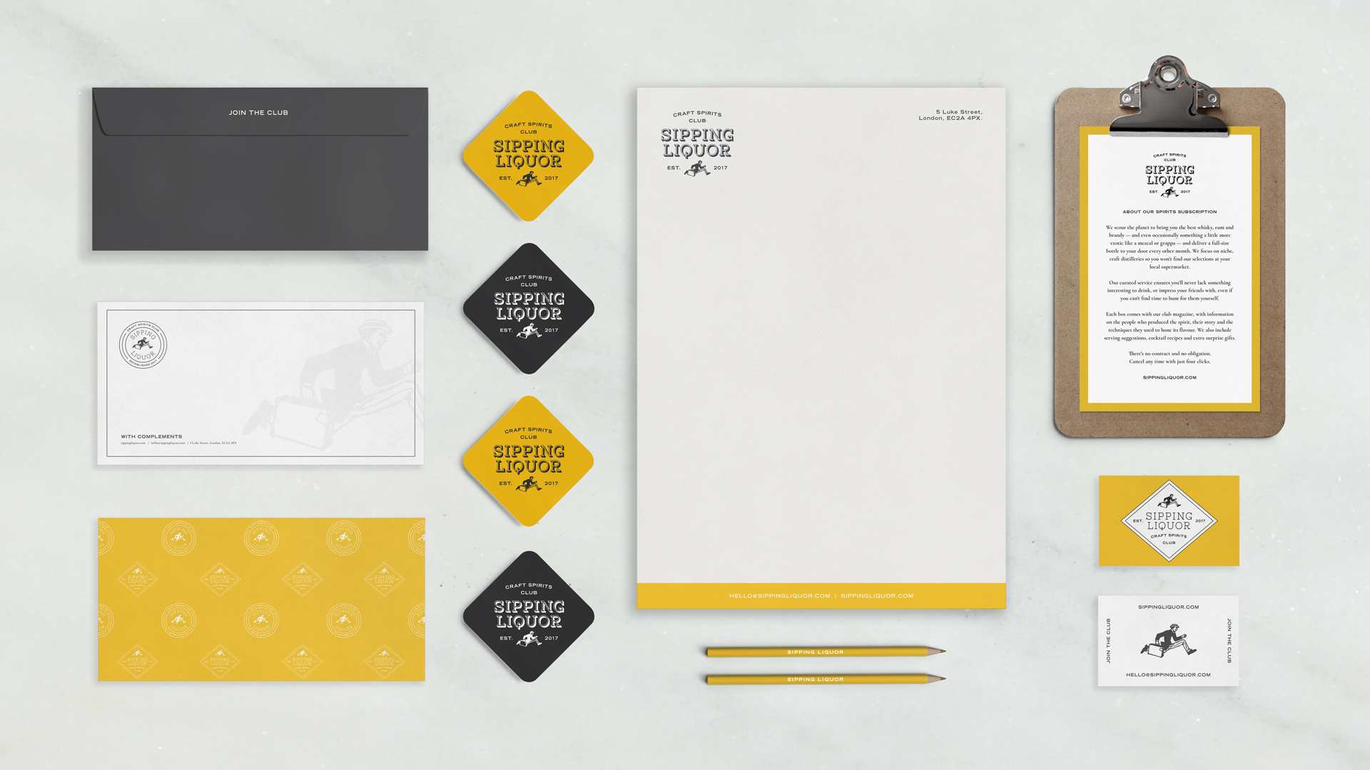 Mockup of various stationary assets for Sipping Liquor- logo featuring graphic of black and white man running. Pencils/ letterheads/envelopes/ business cards. Graphic design by Barefaced Studios, design agency based in Islington, North London.