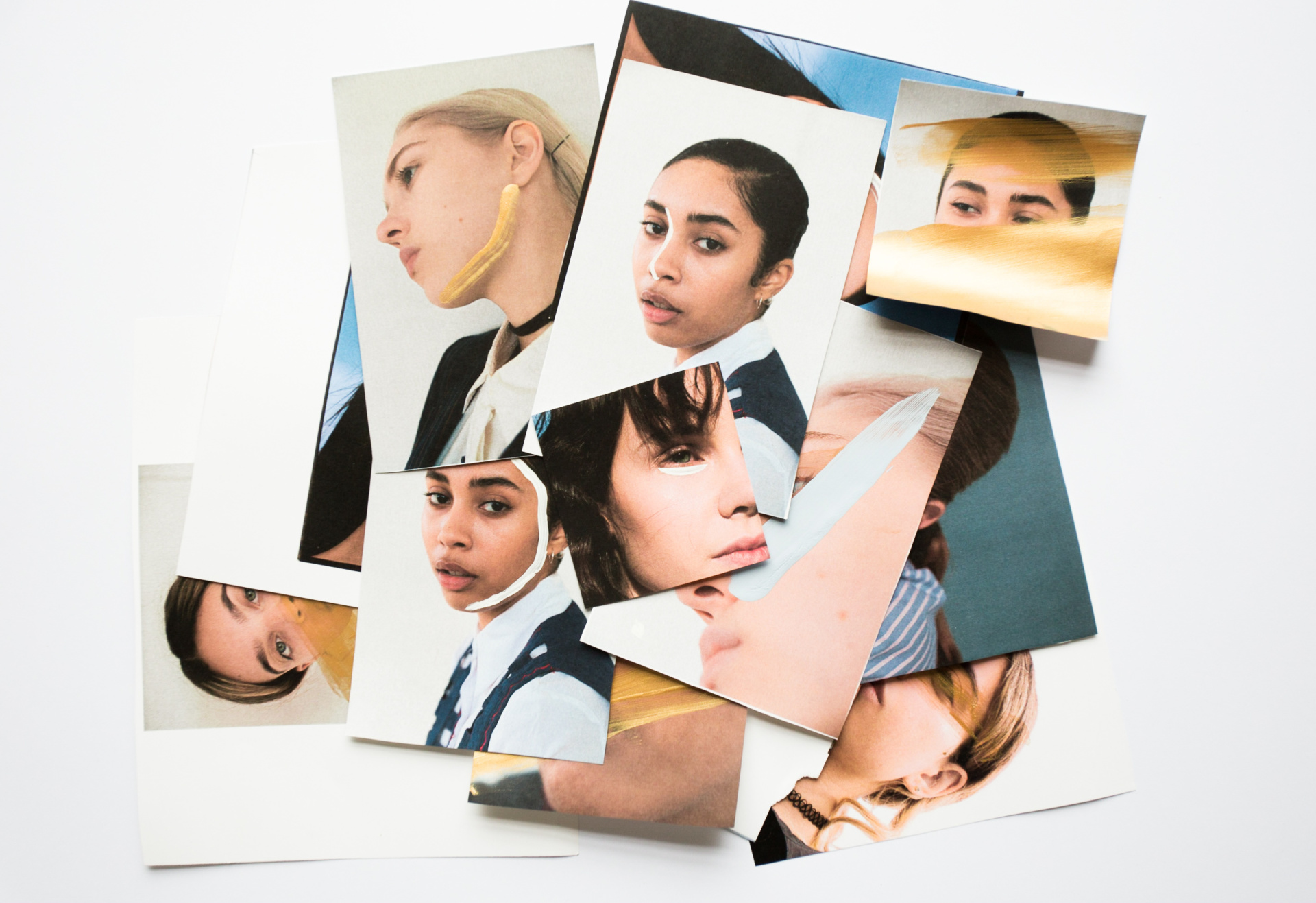 A pile of various photos of women's faces, designed as part of Harley Academy's brand identity. Graphic design by Barefaced Studios, Design Agency in Islington.