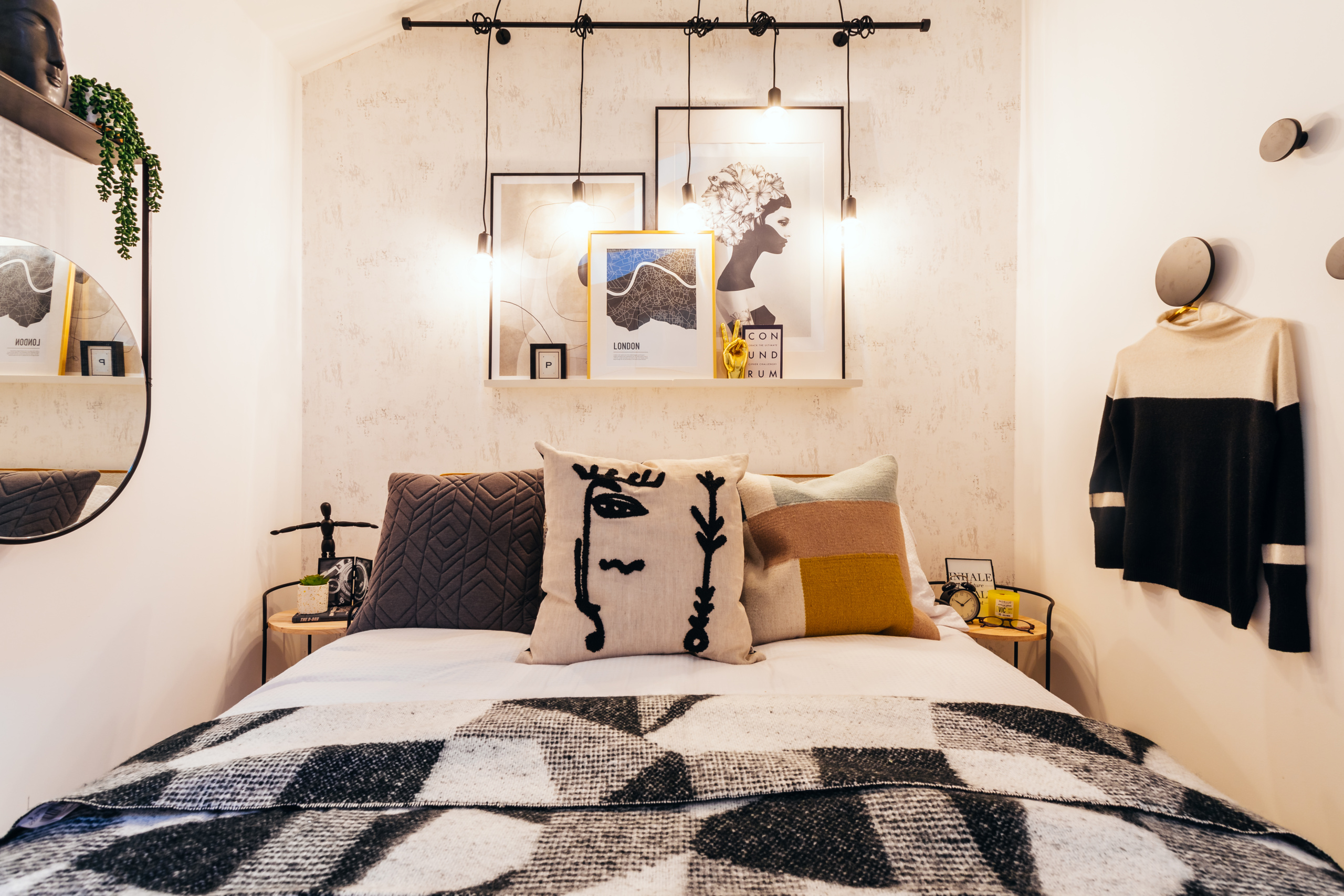 Photograph of the bedroom at the Ironworks Yard development featuring drop pendant lights over a bed.