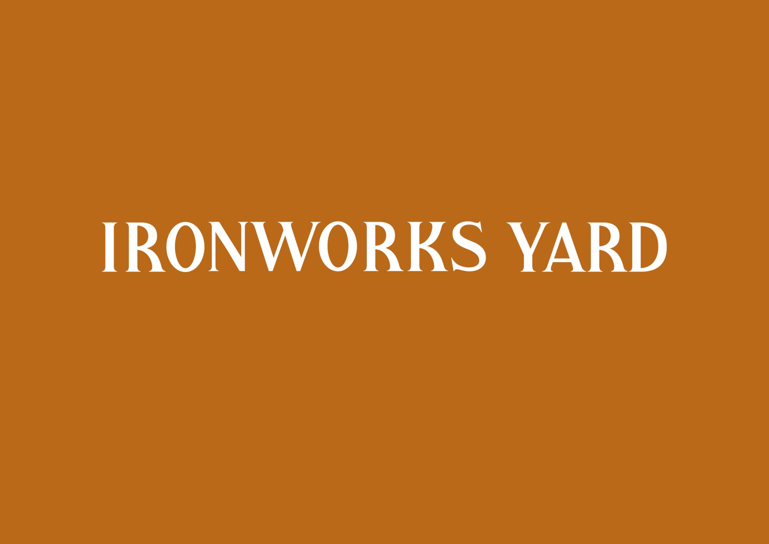 Ironworks Yard Logo in white on burnt orange brand colour